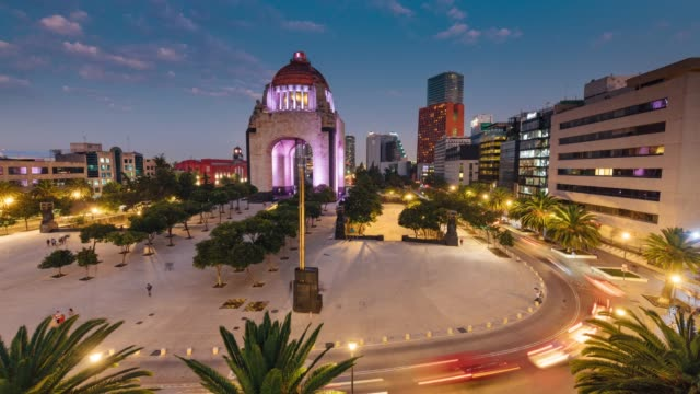 time lapse of the traffic circling revolution monument in mexico city - monument stock videos & royalty-free footage