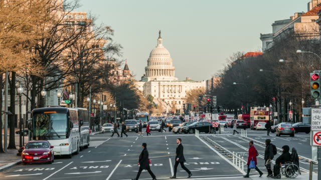 time lapse of the united states capitol building cityscape - washington dc stock videos & royalty-free footage