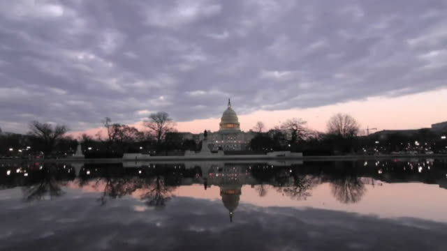 time lapse of the us capitol building - capital cities stock videos & royalty-free footage