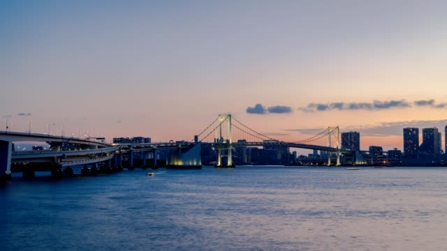 4k time lapse of tokyo cityscape skyline of odaiba area, tokyo bay waterfront at twilight, japan. - sunset to night time lapse stock videos & royalty-free footage