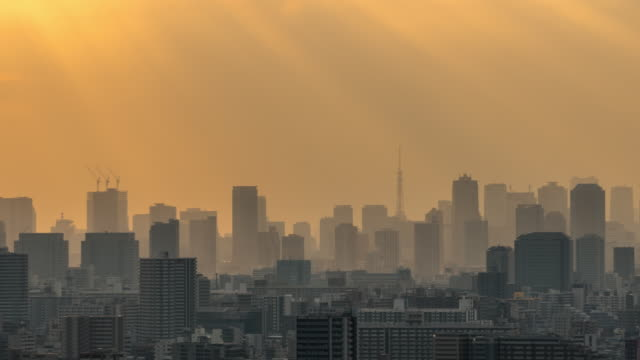 4k time lapse of tokyo skytree locate with various building cityscape at sunset time which have sunbeam from tower hall funabori observation tower, japan - kanto region stock videos & royalty-free footage