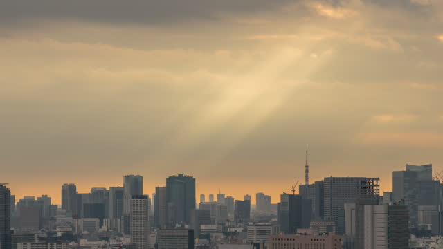 time lapse of tokyo tower locate with various building cityscape at sunset, japan - capital cities stock videos & royalty-free footage