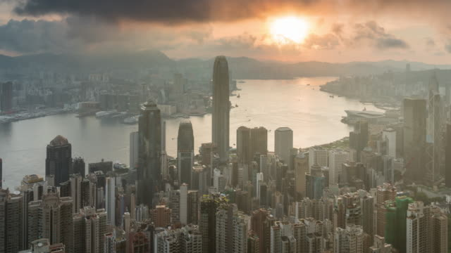 time lapse of top view which can see hong kong cityscape at the sunrise time, 4k clip, business and modern construction and transportation concept - hong kong stock videos & royalty-free footage