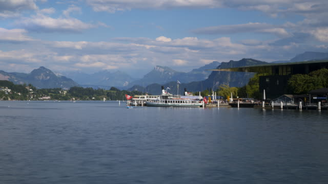 time lapse of tourboats, boats and pedal boats on lake lucerne with lucerne culture and congress centre (on right side). lucerne, lake lucerne, canton of lucerne, switzerland. - lake lucerne stock videos & royalty-free footage
