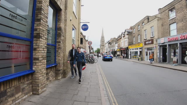 time lapse of tourist pedestrian crowded walking at city center of cambridge uk - british currency stock videos & royalty-free footage