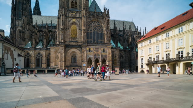 time lapse of tourist walking at st. vitus's cathedral, prague - prague bridge stock videos and b-roll footage