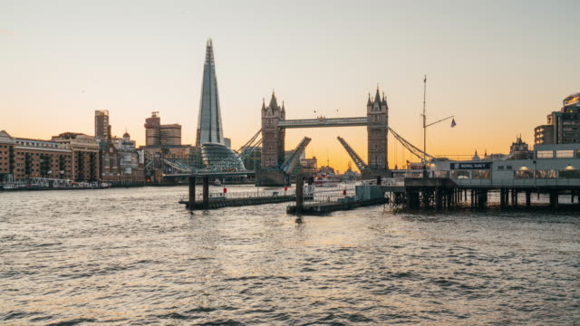 time lapse of tower bridge at sunset opening for a boat in london - suspension bridge stock videos & royalty-free footage