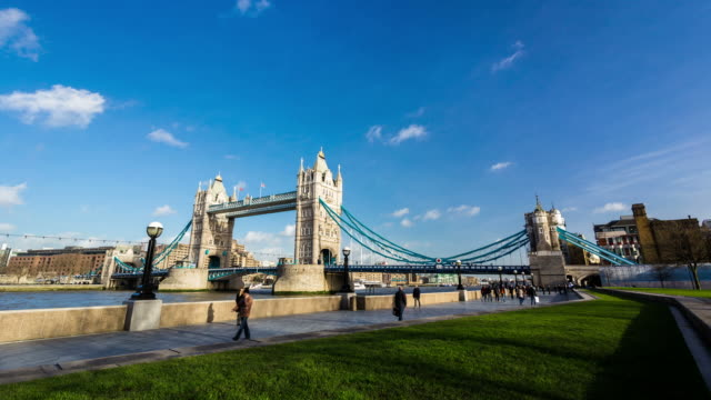 LONDON - CIRCA 2013: Time lapse of Tower Bridge ia a sunny and cloudy day.