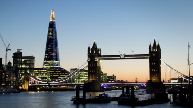ws time lapse of tower bridge london and shard transition at  sunset to night - smith tower stock videos & royalty-free footage