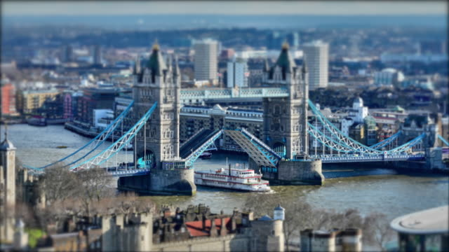 a time lapse of tower bridge opening in london, with tilt shift. - tower bridge stock videos & royalty-free footage