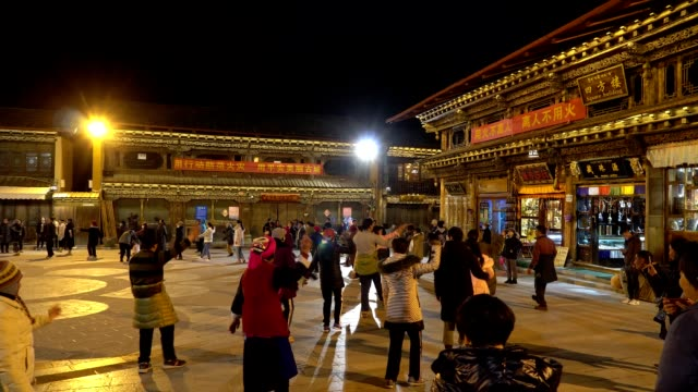 time lapse of traditional dance in the heart of shangri-la, yunnan, china - traditionally tibetan stock videos & royalty-free footage