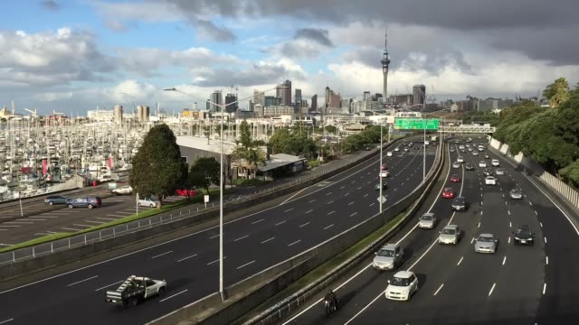 Time Lapse of Traffic Against Auckland City Skyline