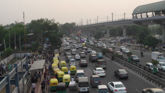 Time lapse of traffic at the busy Chhatarpur metro station crossing in New Delhi, India