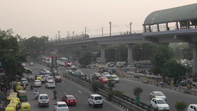 time lapse of traffic at the busy chhatarpur metro station crossing in new delhi, india - rail transportation stock videos & royalty-free footage