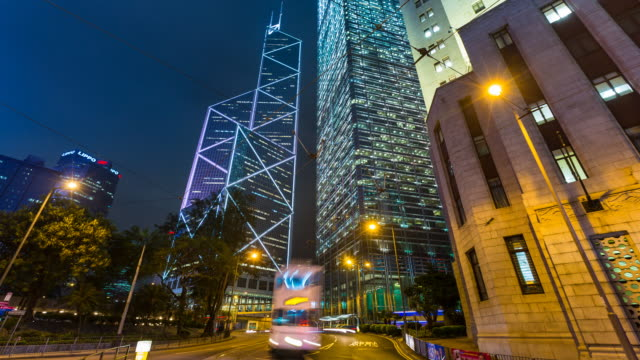 time lapse of traffic in central hong kong at night - bank of china tower hong kong stock videos and b-roll footage