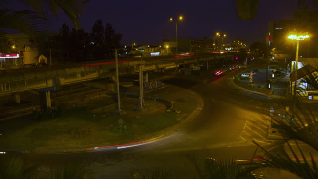 time lapse of traffic in roundabout at night - san jose costa rica stock videos & royalty-free footage