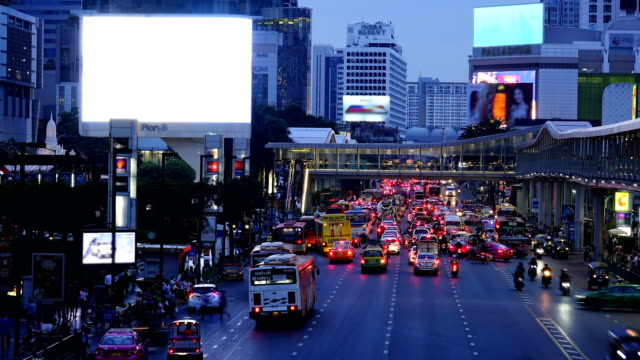time lapse of traffic jam in bangkok , thailand - city street sign stock videos and b-roll footage