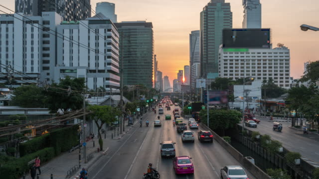 4k time lapse of traffic jam on the sathorn road in rush hour after worker worked at twilight time with fantastic sky, bangkok, thailand, 4k clip, transportation with cityscape concept - bangkok stock videos & royalty-free footage