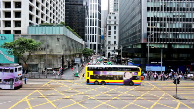 time lapse of traffic of bus and tram along des voeux road in central, hong kong island - hong kong island stock videos & royalty-free footage