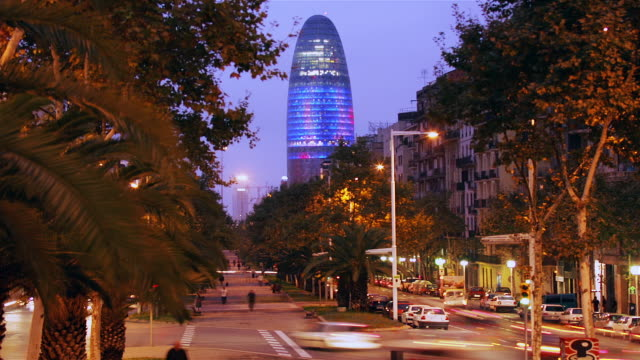 time lapse of traffic on avenida diagonal with view of torre agbar from dusk to night / barcelona, spain - dusk to night stock videos & royalty-free footage