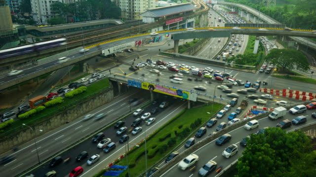 Time lapse of traffic on Federal Highway in Kuala Lumpur, Malaysia. Zoom In.