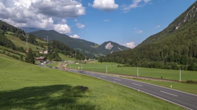 vídeos de stock, filmes e b-roll de time lapse of traffic on major road near mandling, styria, austrian alps, austria, europe - major road