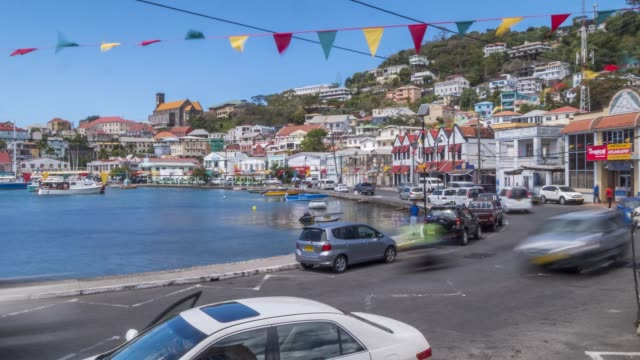 time lapse of traffic on the carenage of st. george's, grenada, windward islands, west indies, caribbean, central america - st. george's grenada stock videos and b-roll footage