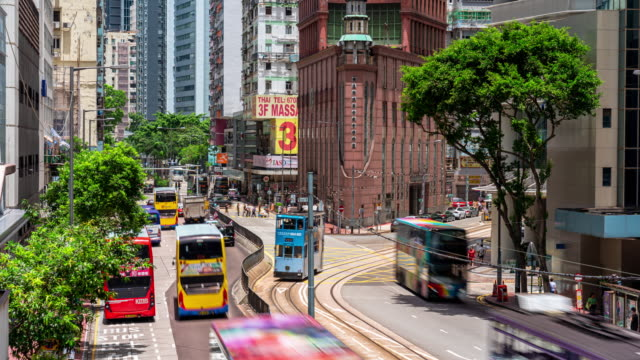 4k time lapse of traffic road in wan chai, hong kong - wan chai stock videos & royalty-free footage