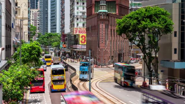 vídeos de stock e filmes b-roll de 4k time lapse of traffic road in wan chai, hong kong - autocarro elétrico