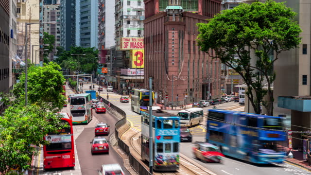 time lapse of traffic road in wan chai, hong kong - trolley bus stock videos & royalty-free footage