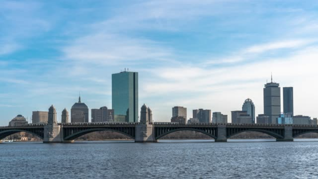 4k time lapse of train running over the longfellow bridge the charles river at the evening time in boston, usa downtown skyline, architecture and building with transportation concept - cambridge massachusetts stock videos & royalty-free footage
