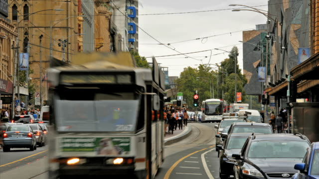Time lapse of trams and street traffic along Flinders street in Melbourne, Australia.
