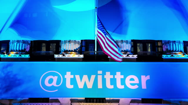 time lapse of twitter inc ipo logo banner hangs outside the new york stock exchange / wall street financial district new york city lower manhattan... - logo stock-videos und b-roll-filmmaterial