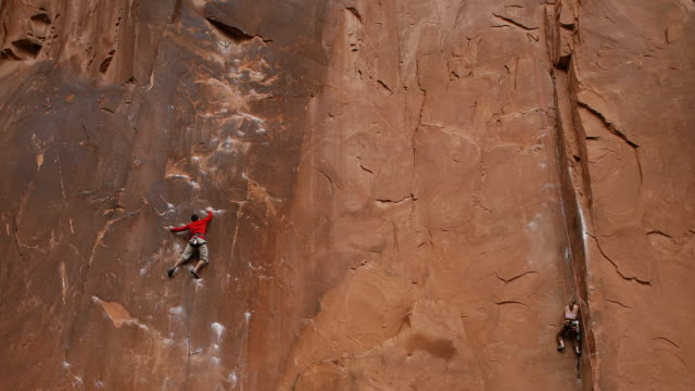 Time lapse of two rock climbers