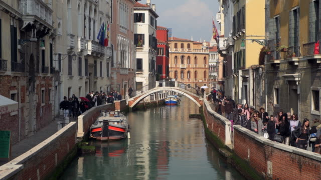time lapse of typical canal in venice. venice, veneto, italy, europe. - tourist stock-videos und b-roll-filmmaterial
