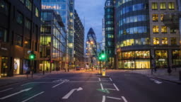 Time lapse of vehicles moving on street against 30 St Mary Axe