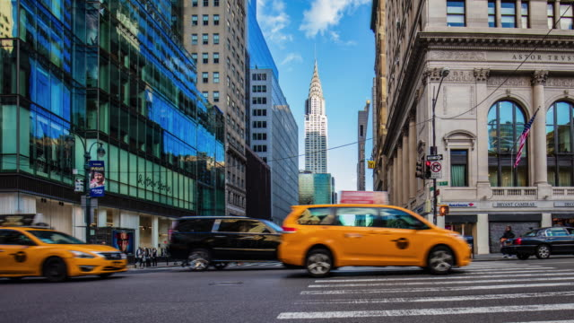 time lapse of vehicles on city street by chrysler building - chrysler building stock videos and b-roll footage