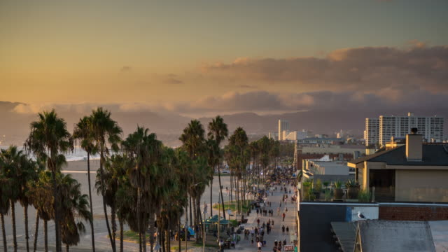 time lapse of venice beach boardwalk at dusk - venice california stock videos & royalty-free footage