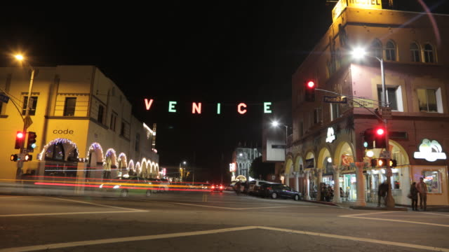 time lapse of venice beach street at night at windward street venice sign - venice california stock videos & royalty-free footage