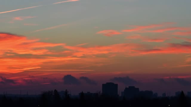 time lapse of vibrant color clouds in the morning - dramatic sky stock videos & royalty-free footage