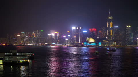 time lapse of victoria harbour in hong kong at night - hong kong island stock videos & royalty-free footage