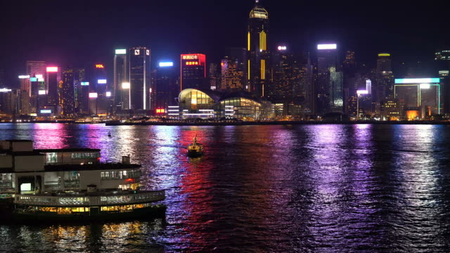 stockvideo's en b-roll-footage met time lapse of victoria harbour in hong kong at night - star ferry
