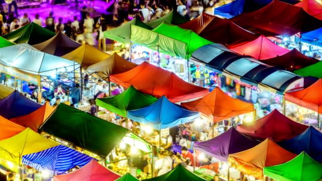 time lapse of walking at night market - night market stock videos & royalty-free footage