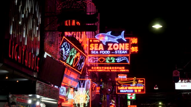 4k t/l time lapse of walking street in pattaya thailand a world famous street of bars, restaurants and entertainment with their collection of neon lights and video signs. groups of tourists like to walk down the street admiring the lights and ladies. - human sexual behaviour stock videos & royalty-free footage