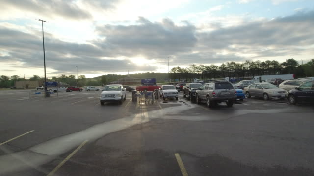 time lapse of walmart super shopping center parking lot at sunrise and customer came early during the 2020 global coronavirus pandemic - tranquil scene stock videos & royalty-free footage