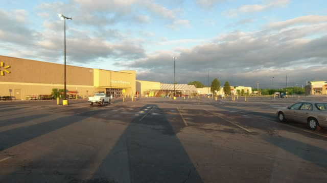 time lapse of walmart super shopping center parking lot at sunrise during the 2020 global coronavirus pandemic ( no audio ) - overexposed stock videos & royalty-free footage