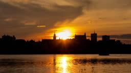 Time Lapse of Warsaw Old Town with Vistula river at sunset