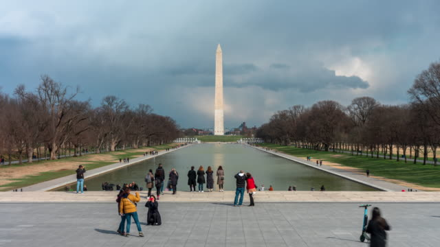 4k time lapse of washington monument is an obelisk on the national mall with reflecting pool and tourist in washington, d.c., usa, architecture and attraction concept - reflecting pool washington dc stock videos & royalty-free footage