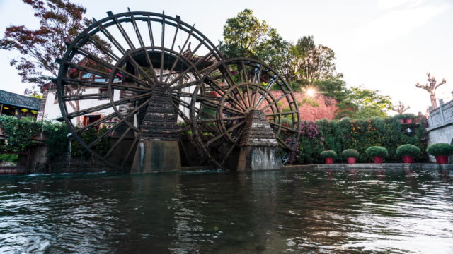 time lapse of watermill in dayan old town, lijiang - watermill stock videos & royalty-free footage