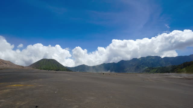 4k time lapse of whispering sands in bromo tengger semeru national park, east java, indonesia. - tengger stock videos & royalty-free footage